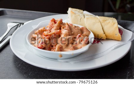 Shrimps in pink sauce with bread aside