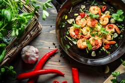 Shrimps on pan with fresh herbs