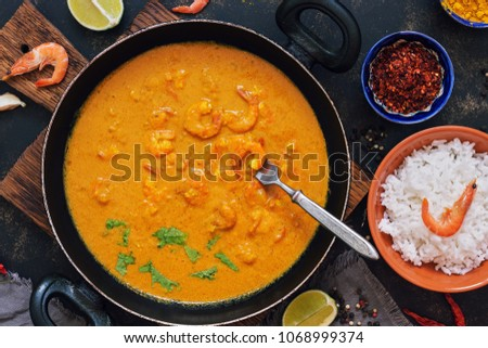 shrimps with curry sauce in a...