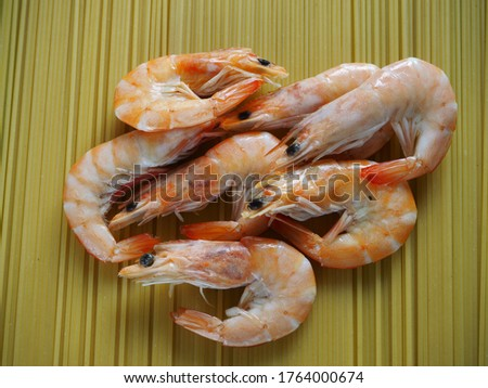 Shrimps with dill and spices closeup. Spaghetti with prawns.   Stock fotó ©