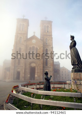 Shrine of Our Lady of La Salette in the French Alps on a foggy day with a view of sculptures in front of the church