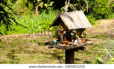 shrine of the household god, household deity, in countryside village made from wood, Chiang Mai, Thailand #1005855235
