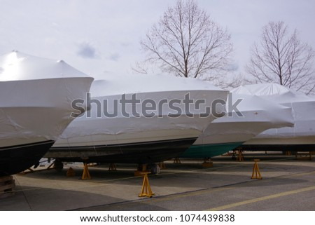Shrink-wrapped boats stored ashore and winterized