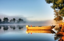 Shrouded by mist a secured boat on the Bellinger River at dawn