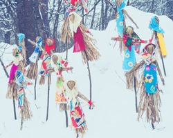 Shrovetide in Russia. Small doll - symbol of Pancakes week, scarecrow for burning as symbol of winter end and spring coming.