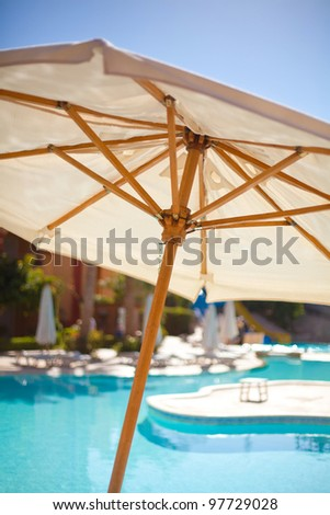 Shunhade umbrella near pool