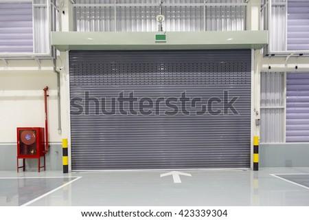 Shutter door or rolling door beige color, in new factory construction site