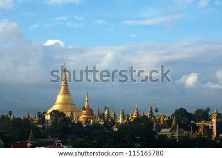 Shwedagon Pagoda Temple with village below  in the morning light at Yangon, Myanmar (Burma)