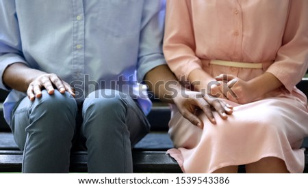 Shy boyfriends tenderly touching knee of his girlfriend sitting on bench, love #1539543386