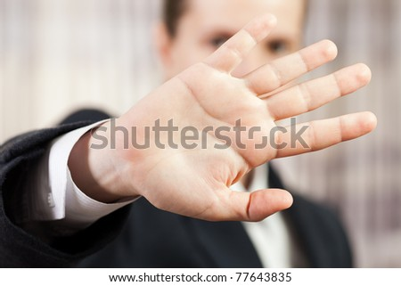 Shy business men hand gesture hide face stop sign