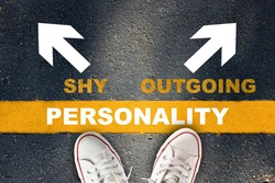Shy or outgoing person concept and understanding relationship in your life idea. Personality written on yellow line with shy and outgoing with white arrow on asphalt road