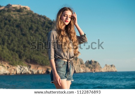Stock Photo Shy pretty girl have relax on the seaside