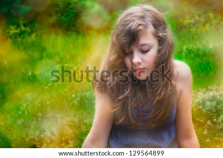 Shy teenage girl alone outside in nature