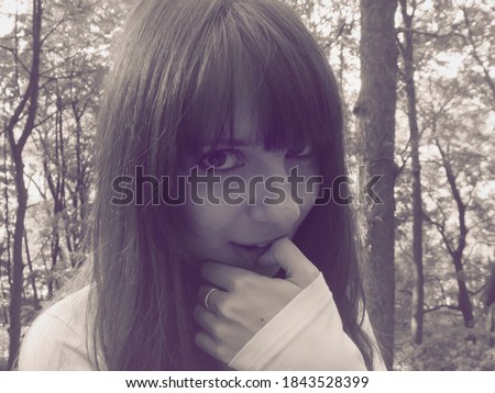 Shy teenage girl looking in camera. Portrait of beautiful brunette woman looking mysteriously. stock photo