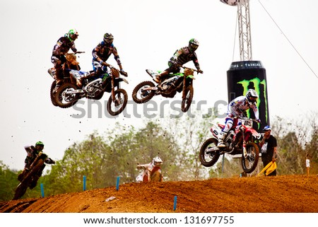 SI RACHA, THAILAND - MAR. 10 : Group of motocross riders jumping during MX1 Grand Prix race 1 of The FIM Motocross World Championship Grandprix of Thailand, on March 10, 2013. Thailand.