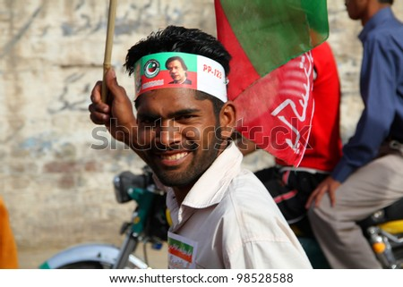 SIALKOT, PAKISTAN - MAR 23: PTI Supporter at Jinnah Cricket Stadium during a political rally of cricketer turned politician Imran Khan on March 23, 2012 in Sialkot, Pakistan