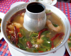Siam Red-tail Catfish in spicy soup. Thailand food.