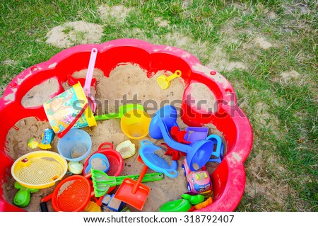 SIANOZETY, POLAND - JULY 19, 2015: Red sand box with plastic toys