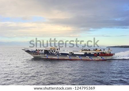 SIARGAO, PHILIPPINES - MAY 16: Fast  ferry boat on the way to Siargao island on May 16, 2012 in Siargao, Philippines. There are 3,219 kilometer of waterways in Philippines.