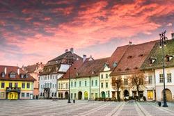 Sibiu, Romania. Colorful clouds on sunrise, Large Square in Sibiu, Transylvania.