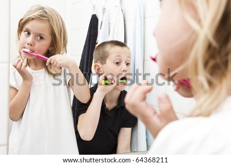 Siblings brushing teeths in the bathroom