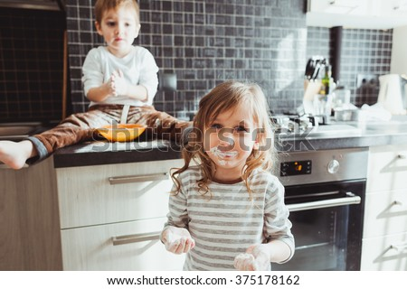 Siblings cooking holiday pie in the kitchen, casual still life photo series