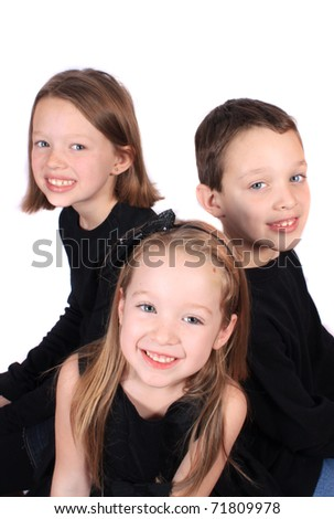 Siblings of different ages, three sisters and one brother on a white background