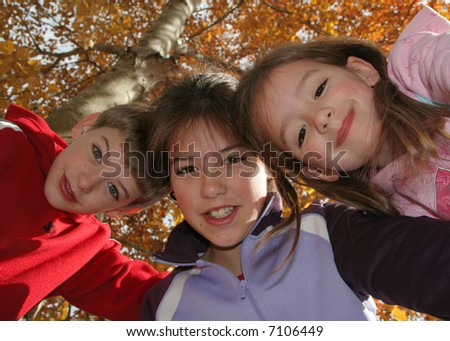 siblings outside on a clear autumn day