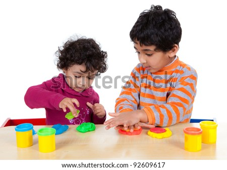 Siblings Playing with Play Dough, Isolated, White