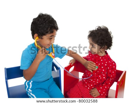 Siblings Posing as Doctor and Patient Indulging in Pretend Play, Isolated, White