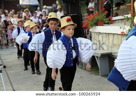 SIC, ROMANIA -AUGUST 24, 2011: unidentified Children between the age of 6-10 are performing in traditional clothes at the Sic Village Festival Days, at August 24, 2011, in Sic (Szek), Romania