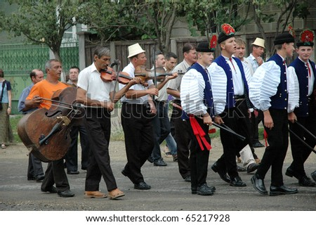Sic, Romania - Circa June 2004: The Wedding Participants Walk Down ...