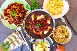 Sichuan cuisine food. Asian Chinese Spicy hot chilli water boiled fish. Chengdu Chongqing  fried chicken. Yangzhou fried rice, dim sum, noodles. Flat lay top view. Food Drink concept.