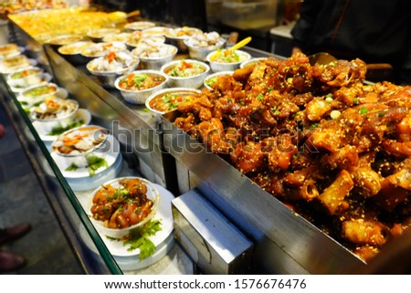 Sichuan style snack like mala pork knuckles, chili oil steam seafood at Jinli ancient street.