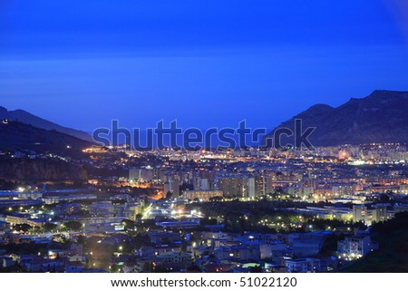 Sicily: panoramic night cityscape of Palermo facing the Mediterranean sea