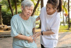 Sick asian senior woman with belly pain,elderly have severe stomach ache,left side,patient with acute pancreatitis hold hand left stomachache,abdominal pain,inflammatory bowel disease,irritable bowel