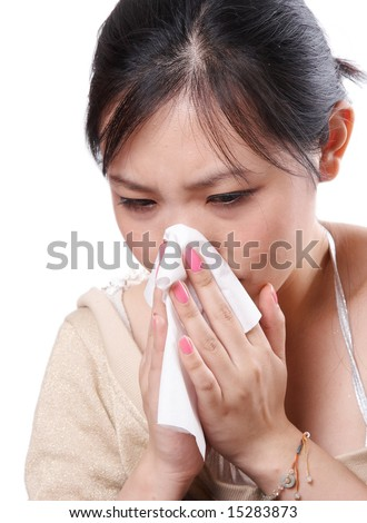 Sick asian woman blowing her nose with tissues, isolated on white
