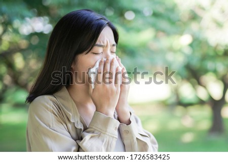 Sick Asian woman in outdoor Stock photo ©