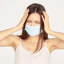 Sick beauty white girl with protective mask. Pandemic quarantine corona virus. Illness influenza patient. Anti flu treatment.
