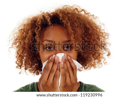 Sick black woman with a flu, sneezing closeup isolated over white
