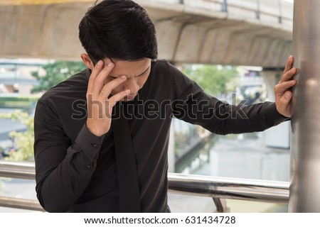 sick businessman suffering from stress, headache, vertigo, migraine, emotional problem #631434728