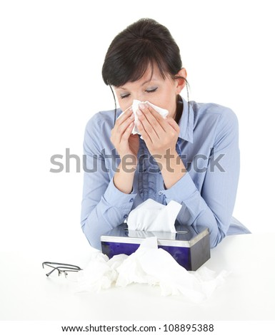 sick businesswoman with flu blowing nose in tissue, white background