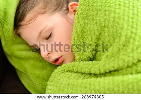 Sick child. Sick sleeping little girl under a blanket.