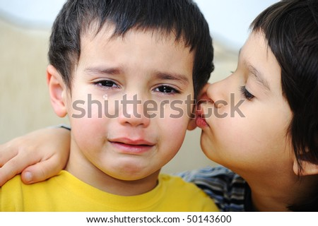 Sick crying kid and his brother
