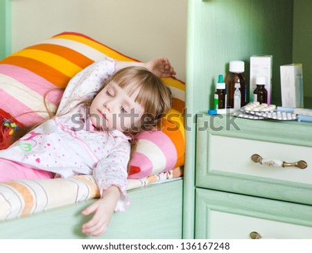sick girl lying on a bed