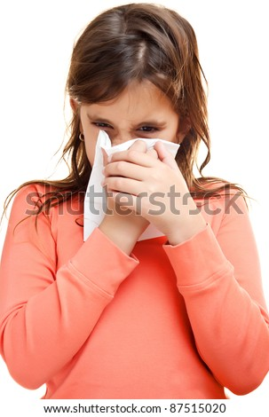 Sick girl sneezing on a paper tissue isolated on white - stock photo