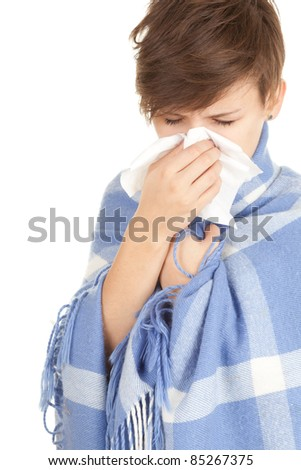 sick girl with flu wrapped up with warm blanket blowing her nose, series