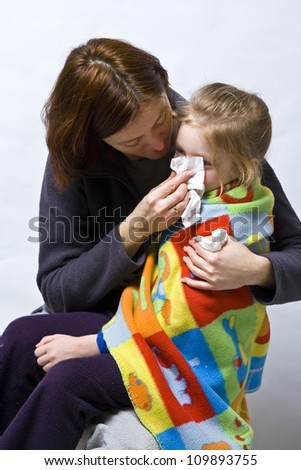 Sick litle girl on her mother knees