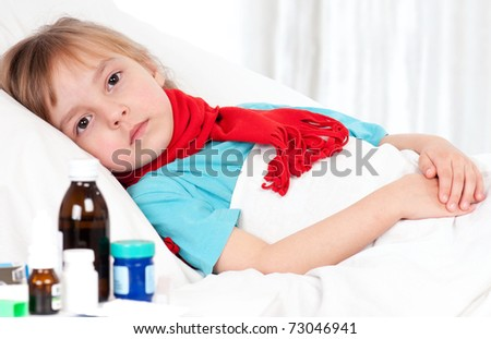 Sick little beautiful girl with red scarf in the bed