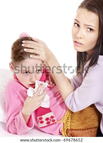 Sick little girl with handkerchief in bed.